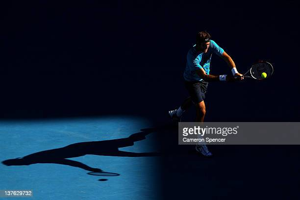 Juan Martin Del Potro of Argentina plays a backhand in his quarter final match against Roger Federer of Switzerland during day nine of the 2012...