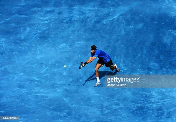 Juan Martin Del Potro of Argentina plays a doublehanded backhand in his semi final match against Tomas Berdych of the Czech Republic during the Mutua...
