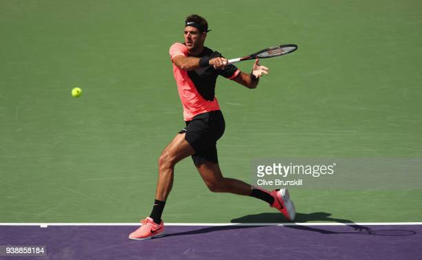 Juan Martin Del Potro of Argentina plays a forehand against Filip Krajinovic of Serbia in their fourth round match during the Miami Open Presented by...