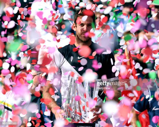 Juan Martin Del Potro of Argentina poses with the trophy after his victory over Roger Federer of Switzerland in the ATP final during the BNP Paribas...