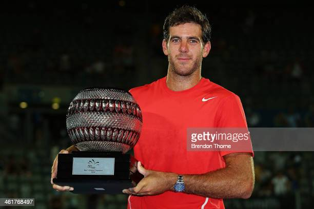 Juan Martin Del Potro of Argentina poses with the trophy after winning the mens singles final against BernardTomic of Australia during day seven of...
