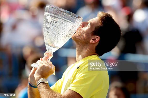 Juan Martin Del Potro of Argentina poses with the winner's trophy after defeating John Isner during the final of the Citi Open at the William HG...
