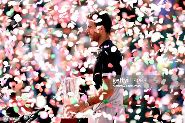 Juan Martin Del Potro of Argentina poses with the winner's trophy after defeating Roger Federer of Switzerland during the men's final on Day 14 of...