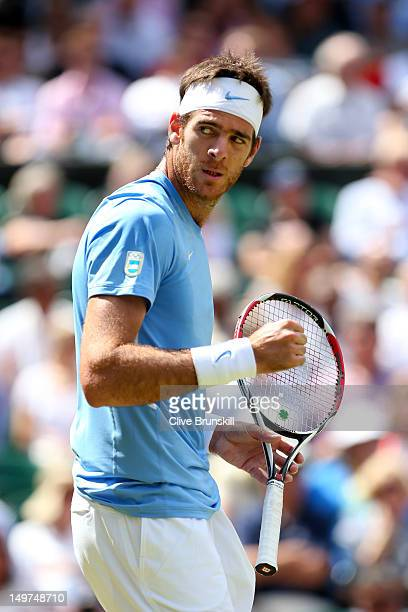 Juan Martin Del Potro of Argentina reacts after a point against Roger Federer of Switzerland in the Semifinal of Men's Singles Tennis on Day 7 of the...