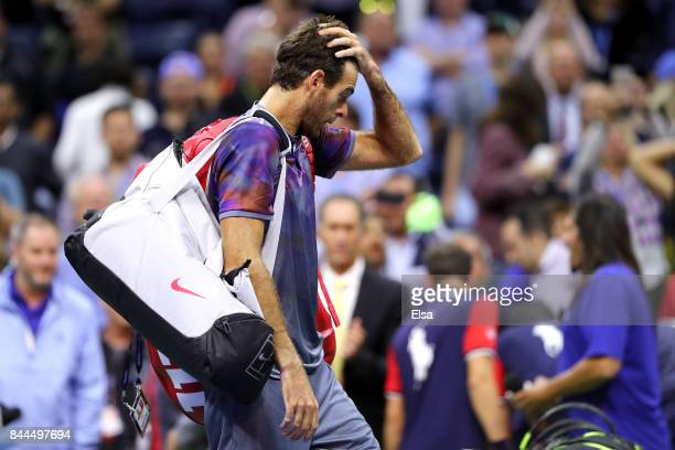 Juan Martin del Potro of Argentina reacts after being defeated by Rafael Nadal of Spain after their Men's Singles Semifinal match on Day Twelve of...