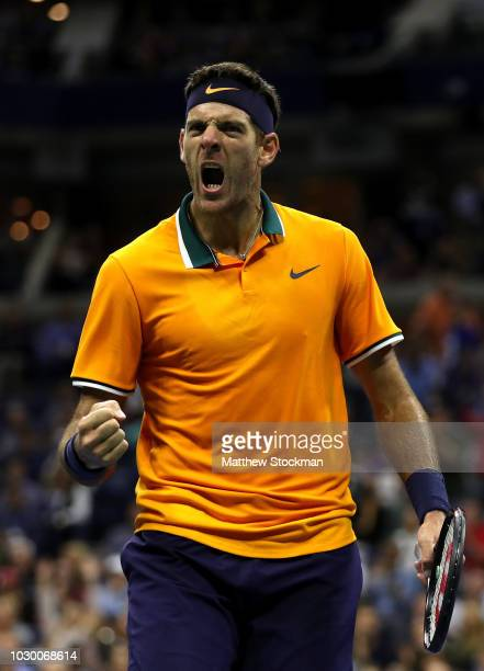 Juan Martin del Potro of Argentina reacts after winning a game during his men's Singles finals match against Novak Djokovic of Serbia on Day Fourteen...