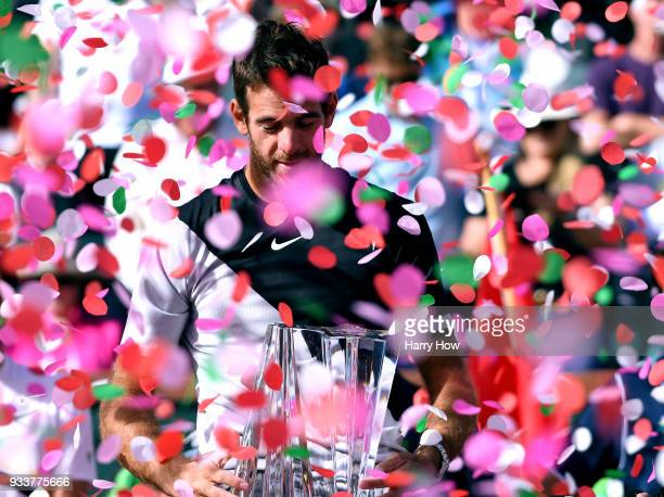 Juan Martin Del Potro of Argentina reacts with the trophy after his victory over Roger Federer of Switzerland in the ATP final during the BNP Paribas...