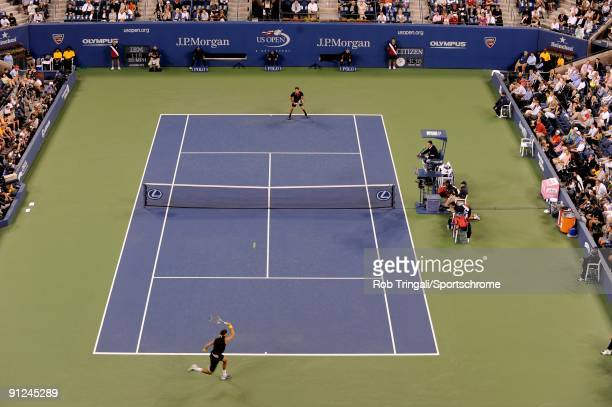 Juan Martin Del Potro of Argentina returns a ball to Roger Federer of Switzerland in the Men's Singles final on day fifteen of the 2009 US Open at...