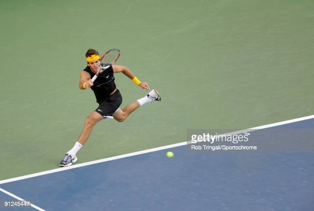 Juan Martin Del Potro of Argentina returns a ball to Roger Federer of Switzerland in the Men's Singles final on day fifteen of the 2009 U.S. Open at...