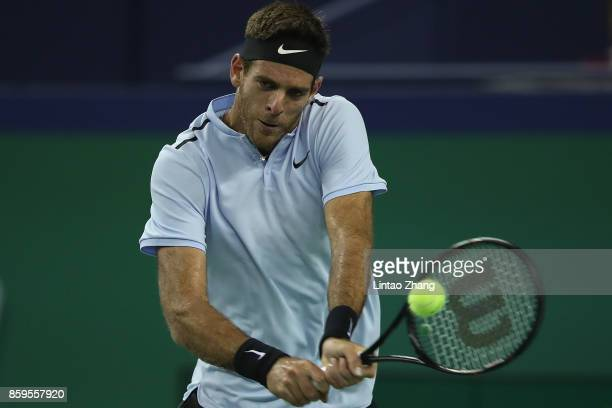 Juan Martin del Potro of Argentina returns a shot against during the Men's singles mach against Nikoloz Basilashvili of Georgia on day two of...
