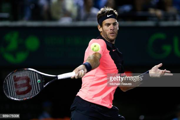 Juan Martin Del Potro of Argentina returns a shot against Milos Raonic of Canada during their quarterfinal match on Day 10 of the Miami Open...