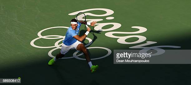 Juan Martin Del Potro of Argentina returns a shot against Rafael Nadal of Spain during the Men's Singles Semifinal Match on Day 8 of the Rio 2016...