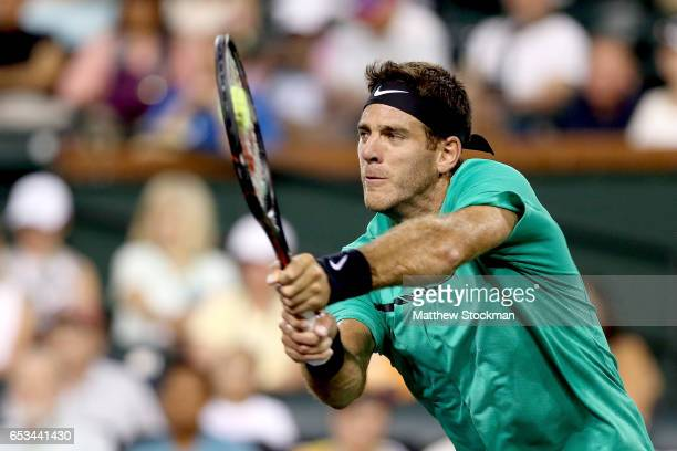 Juan Martin Del Potro of Argentina returns a shot to Novak Djokovic of Serbia during the BNP Paribas Open at the Indian Wells Tennis Garden on March...