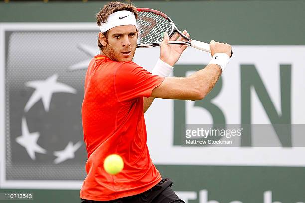 Juan Martin Del Potro of Argentina returns a shot to Philipp Kohlschreiber of Germany during the BNP Paribas Open at the Indian Wells Tennis Garden...