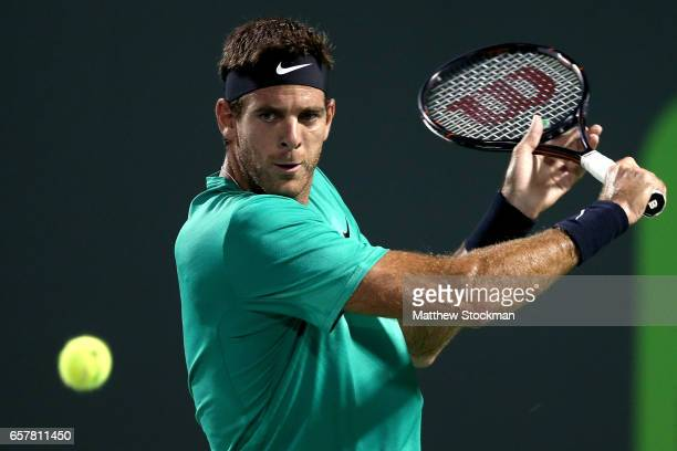 Juan Martin Del Potro of Argentina returns a shot to Robin Hasse of Netherlands during the Miami Open at the Crandon Park Tennis Center on March 25...