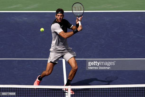 Juan Martin Del Potro of Argentina returns a shot to Roger Federer of Switzerland during the men's final on Day 14 of the BNP Paribas Open at the...