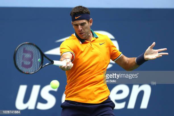 Juan Martin del Potro of Argentina returns the ball during his men's singles semifinal match against Rafael Nadal of Spain on Day Twelve of the 2018...