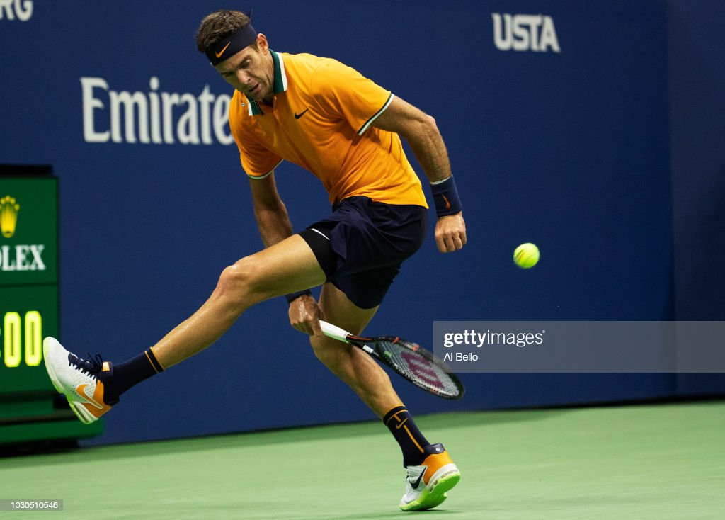 Juan Martin del Potro of Argentina returns the ball through his legs during his men's Singles finals match against Novak Djokovic of Serbia on Day Fourteen of the 2018 US Open at the USTA Billie Jean King National Tennis Center on September 9, 2018 in the Flushing neighborhood of the Queens borough of New York City.