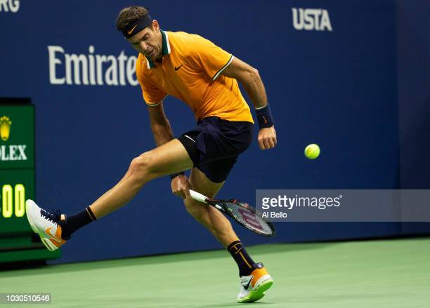 Juan Martin del Potro of Argentina returns the ball through his legs during his men's Singles finals match against Novak Djokovic of Serbia on Day...