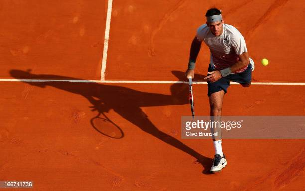Juan Martin Del Potro of Argentina runs for the ball against Alexandr Dolgopolov of the Ukraine in their second round match during day three of the...