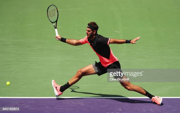 Juan Martin Del Potro of Argentina runs to play a forehand against John Isner of the United States in their semifinal match during the Miami Open...
