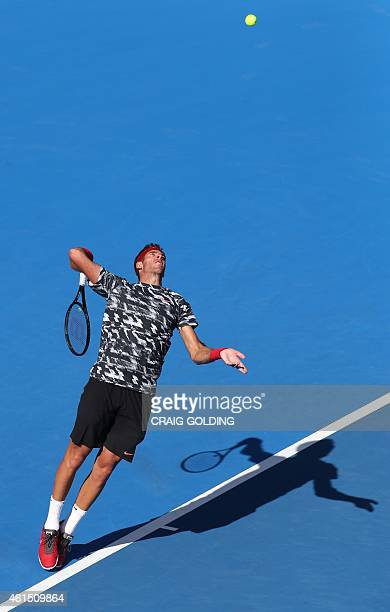 Juan Martin Del Potro of Argentina serves against Fabio Fognini of Italy during their men's singles match on day four of the Sydney International...