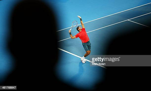 Juan Martin Del Potro of Argentina serves in the Mens Single Final against Bernard Tomic of Australia during day seven of the Sydney International at...