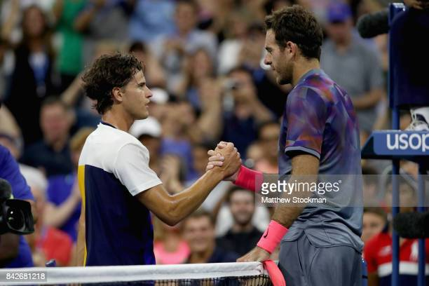 Juan Martin del Potro of Argentina shakes hands with Dominic Thiem of Austria after defeating him in their fourth round Men's Singles match on Day...