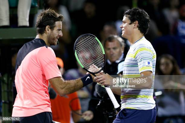 Juan Martin Del Potro of Argentina shakes hands with Milos Raonic of Canada after their quarterfinal match on Day 10 of the Miami Open Presented by...