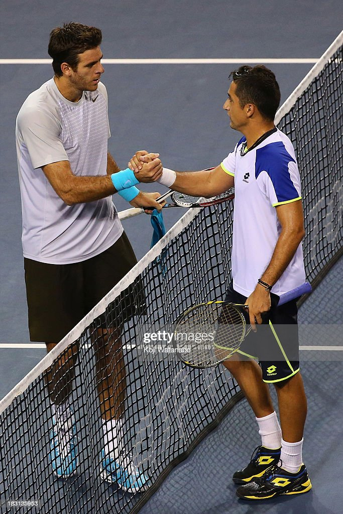Juan Martin Del Potro of Argentina (L) shakes hands with Nicolas Almagro of Spain after men's singles semi final match during day six of the Rakuten Open at Ariake Colosseum on October 5, 2013 in Tokyo, Japan.