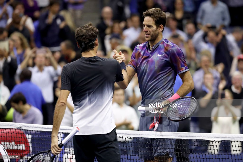 Juan Martin del Potro (R) of Argentina shakes hands with Roger Federer (L) of Switzerland after their Men's Singles Quarterfinal match on Day Ten of the 2017 US Open at the USTA Billie Jean King National Tennis Center on September 6, 2017 in the Flushing neighborhood of the Queens borough of New York City.