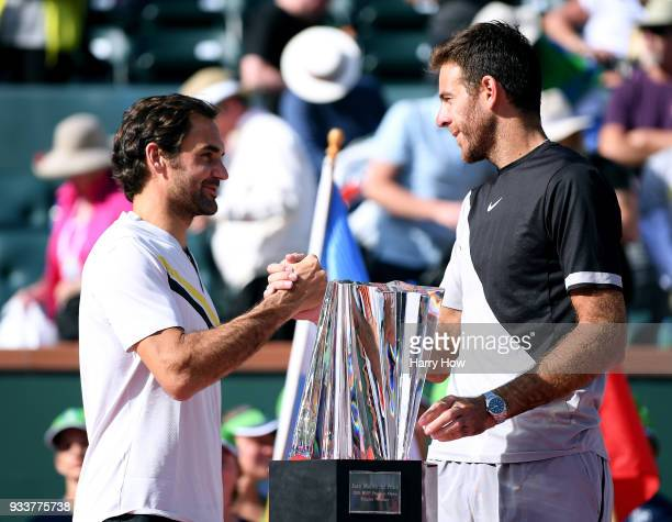 Juan Martin Del Potro of Argentina shakes hands with Roger Federer of Switzerland at the trophy presentation after a three set victory in the ATP...