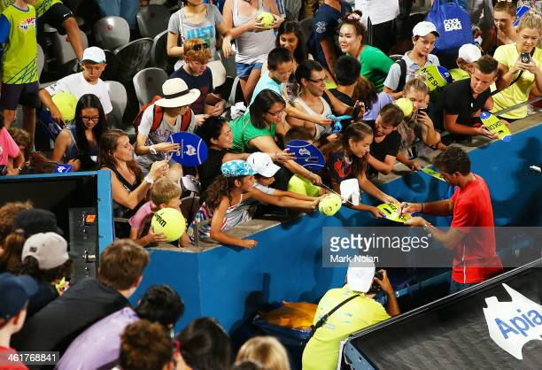 Juan Martin Del Potro of Argentina signs autographs for fans after winning the Mens Single Final against Bernard Tomic of Australia during day seven...