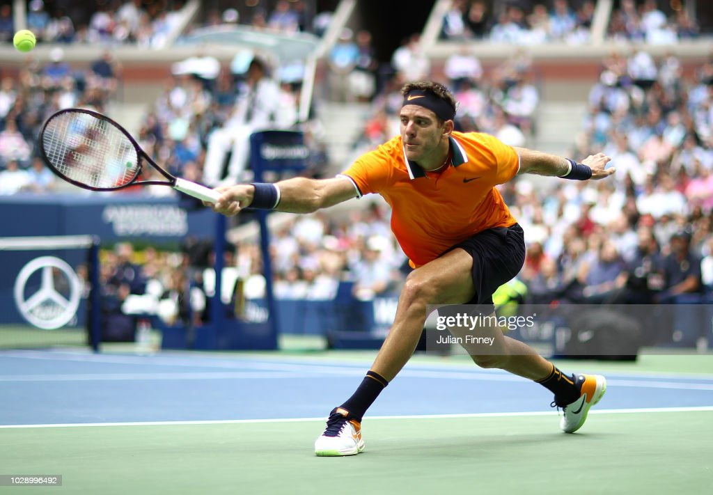 Juan Martin del Potro of Argentina stretches for a backhand in his match against Rafael Nadal of Spain in the men's singles semi-final match on Day Twelve of the 2018 US Open at the USTA Billie Jean King National Tennis Center on September 7, 2018 in the Flushing neighborhood of the Queens borough of New York City.