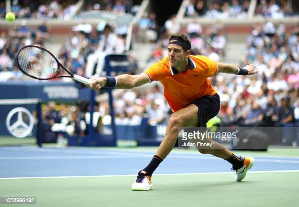 Juan Martin del Potro of Argentina stretches for a backhand in his match against Rafael Nadal of Spain in the men's singles semifinal match on Day...