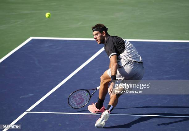 Juan Martin Del Potro of Argentina volleys against Roger Federer of Switzerland during the men's final on Day 14 of BNP Paribas Open on March 18 2018...