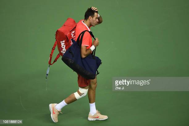 Juan Martin del Potro of Argentina walks off the court after he is forced to retire due to injury against Borna Coric of Croatia during third round...