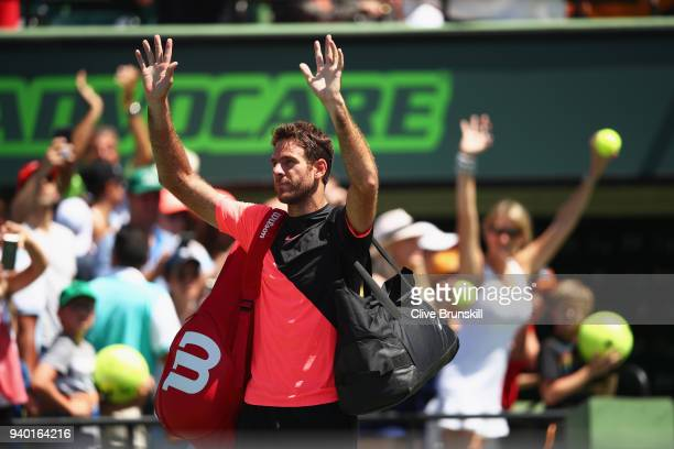 Juan Martin Del Potro of Argentina waves to the crowd as he walks off court after his straight sets defeat by John Isner of the United States in...