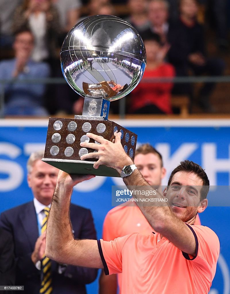 Juan Martin Del Potro poses with the trophy during an award ceremony after defeating USA's Jack Sock at the ATP Stockholm Open tennis tournament final match on October 23, 2016 in Stockholm. / AFP / JONATHAN