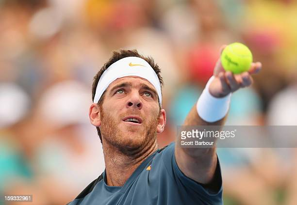 Juan Martin Del Potro serves during his match against Lleyton Hewitt of Australia of Argentina during day four of the AAMI Classic at Kooyong on...