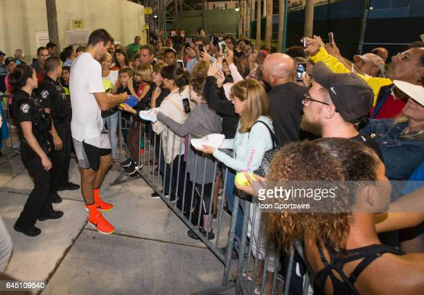 Juan Martin del Potro signs autographs for fans after defeating Sam Querrey during the Quarterfinals of the ATP Delray Beach Open on February 24,...