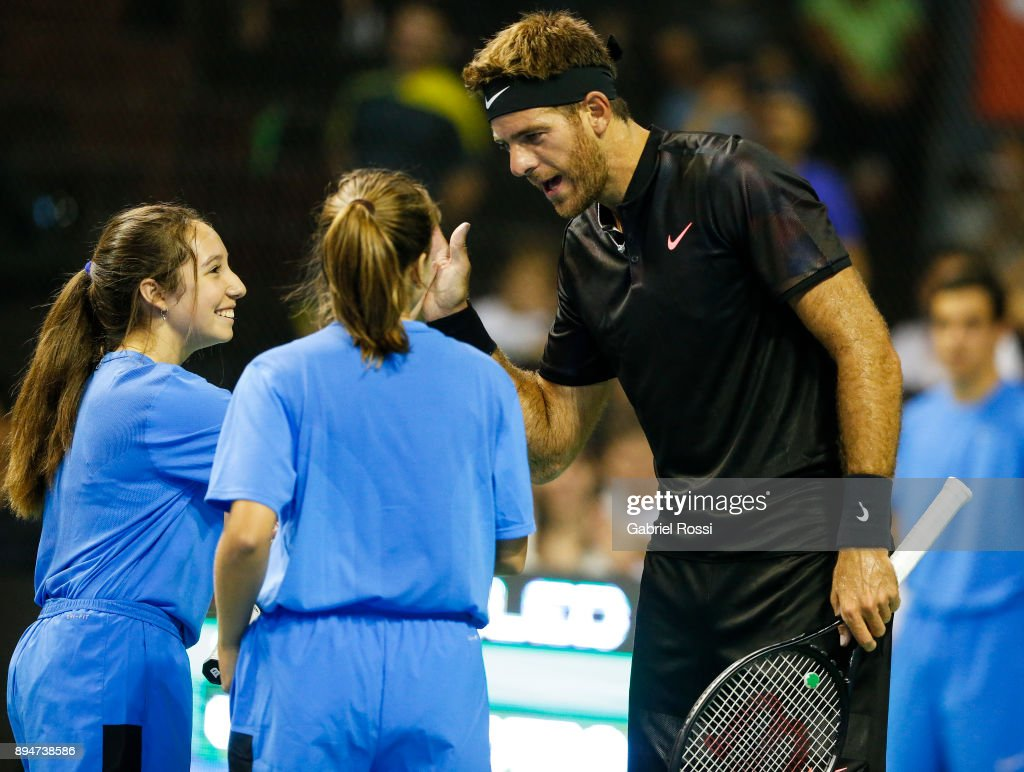 Juan Martin Del Potro talks with ballgirls during an exhibition match between Juan Martin Del Potro and Nick Kyrgios at Luna Park on December 15, 2017 in Buenos Aires, Argentina.