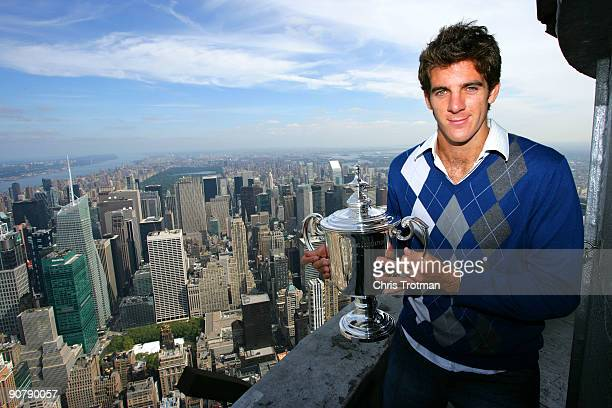 Juan Martin Del Potro the 2009 US Open Tennis Champion poses with the US Open trophy on a viewing deck at the Empire State Building on September 15...