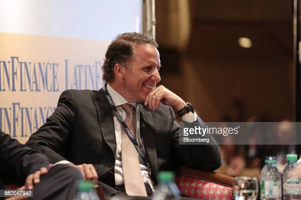 Juan Martin Molinari director of investment banking at Advanced Capital Securities SA smiles during the Argentina SubSovereign and Infrastructure...