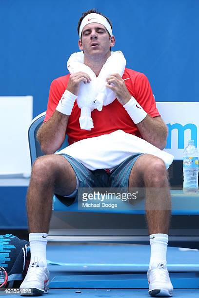 Juan Martn Del Potro of Argentina feels the heat in his first round match against Rhyne Williams of the United States during day two of the 2014...