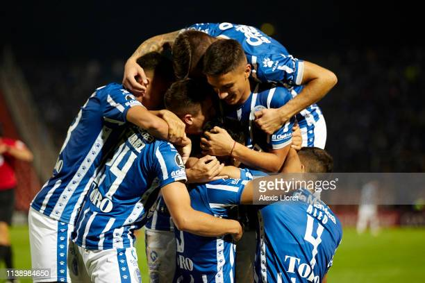 Juan Martín Lucero of of Godoy Cruz celebrates with teammates after scoring the second goal of his team during a group C match between Godoy Cruz and...
