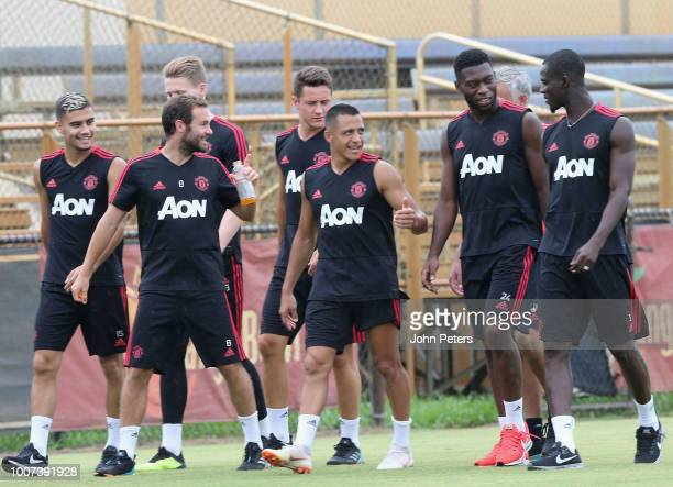 Juan Mata Alexis Sanchez Timothy FosuMensah and Eric Bailly of Manchester United in action during a first team training session as part of their...