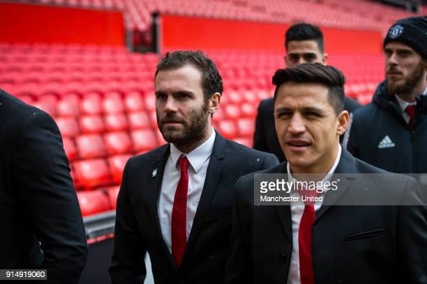 Juan Mata and Alexis Sanchez of Manchester United attend a service to commemorate the 60th anniversary of the Munich Air Disaster at Old Trafford on...