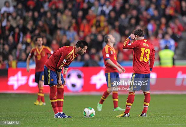 Juan Mata and Alvaro Negredo of Spain react after Finland scored the equalizing goal during the FIFA 2014 World Cup Qualifier between Spain and...