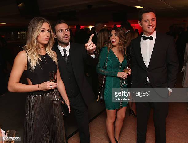 Juan Mata and Ander Herrera of Manchester United attend the annual United for UNICEF dinner at Old Trafford on October 31 2016 in Manchester England